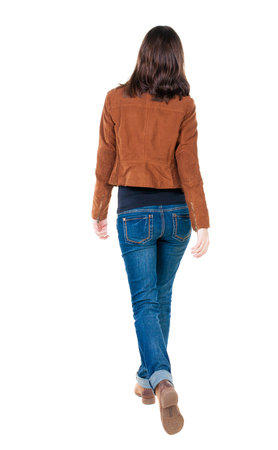back view of walking  woman in brown jacket. beautiful brunette girl in motion.  backside view of person.  Rear view people collection. Isolated over white background.