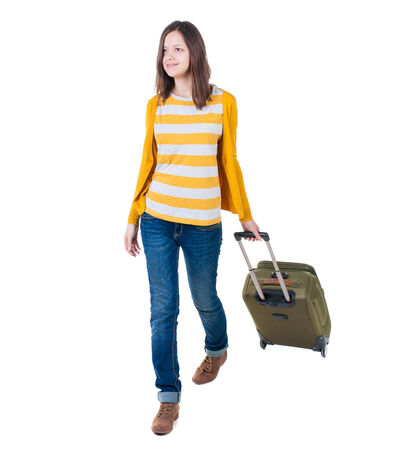 front view of walking  woman  with suitcase photo