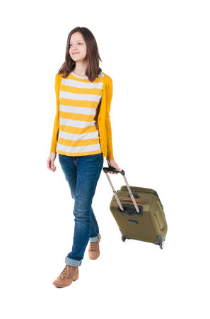 front view of walking  woman  with suitcase. photo