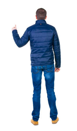 Back view of  man in blue jacket shows thumbs up. photo