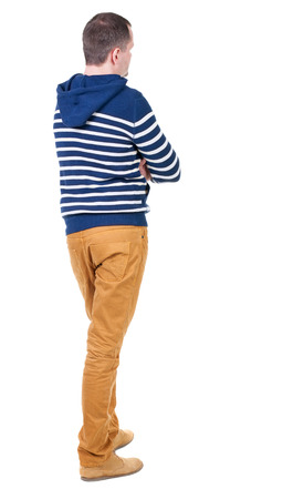 man behind: Back view of handsome man in striped hooded sweater. Stock Photo