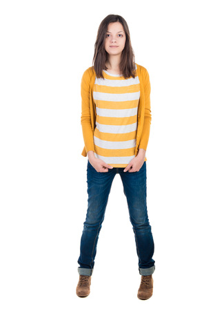 A young woman standing in jeans and a T-shirt. te photo