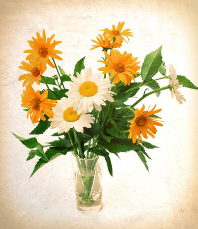 bouquet of wild flowers in a vase. photo