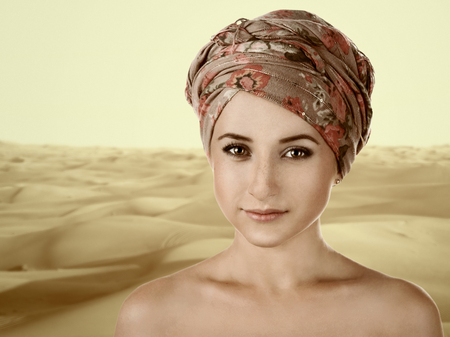 portrait of white-skinned girl in a turban. caucasian woman with freckles.  photo
