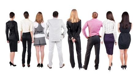 personas mirando: Vista posterior del equipo de negocios mira la pared. La gente de negocios trabajo en equipo en busca de algo. Foto de archivo