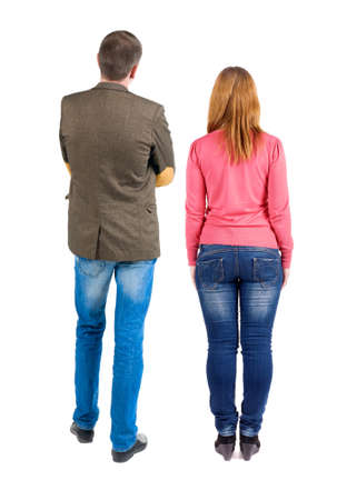 brunete: Back view of young couple (man and woman) hug and look into the distance. beautiful friendly girl and guy together.