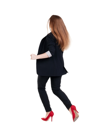 running business woman. back view. going young girl in  suit. Rear view people collection.  back side view of person.  Isolated over white background. photo