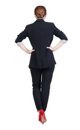 back view of redhead business woman contemplating. Young girl in suit.  Rear view people collection.  backside view of person.  Isolated over white background. photo