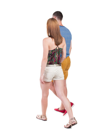 people walking white background:  Back view going couple in shorts. walking friendly girl and guy holding hands. Rear view people collection. backside view of person. Isolated over white background.  Stock Photo