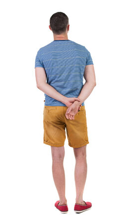 Back view of young manin shorts looking.  Rear view people collection.  backside view of person.  Isolated over white background.