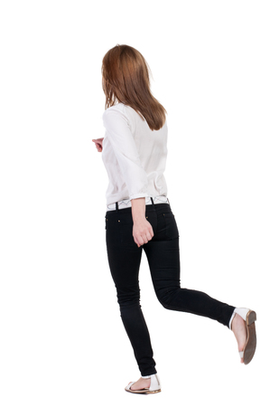 back view of running  woman in white shirt. beautiful blonde girl in motion. backside view of person.  Rear view people collection. Isolated over white background. photo