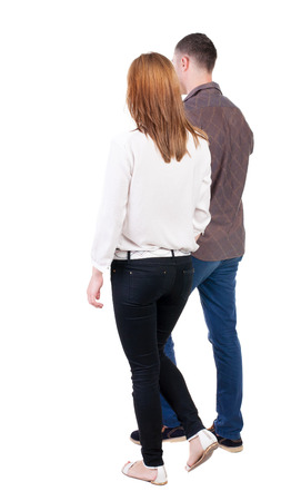 side:  Back view going couple. walking friendly girl and guy holding hands. Rear view people collection. backside view of person. Isolated over white background.  Stock Photo