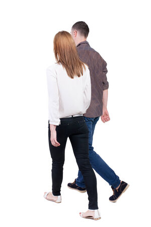 treading:  Back view going couple. walking friendly girl and guy holding hands. Rear view people collection. backside view of person. Isolated over white background.  Stock Photo