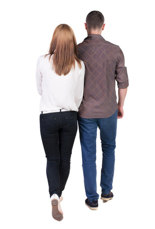 girls back to back:  Back view going couple. walking friendly girl and guy holding hands. Rear view people collection. backside view of person. Isolated over white background.  Stock Photo