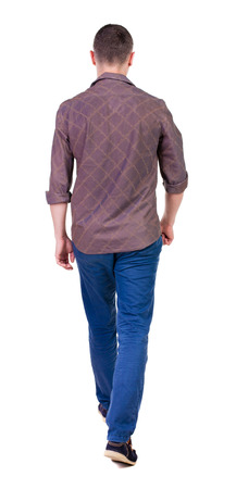 Back view of going  handsome man in jeans and a shirt.  walking young guy . Rear view people collection.  backside view of person.  Isolated over white background. photo