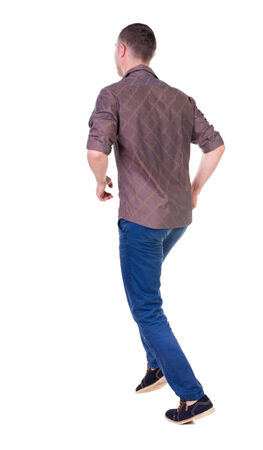 Back view of running man in brown shirt. Walking guy in motion. Rear view people collection. Backside view of person. Isolated over white background. photo