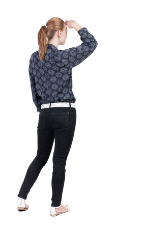 back view of standing young beautiful  blonde woman in jeans. girl  watching. Rear view people collection.  backside view of person.  Isolated over white background. photo