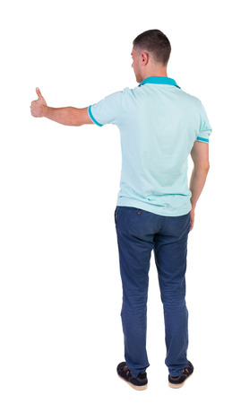 Back view of  man in checkered shirt shows thumbs up.   Rear view people collection.  backside view of person.  Isolated over white background. photo