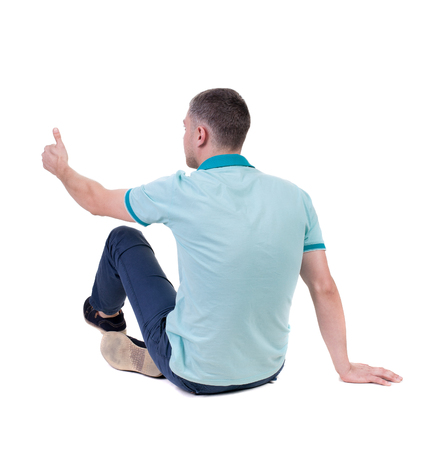 Back view of  man in checkered shirt shows thumbs up. sitting man showing victory sign. Rear view people collection.  backside view of person.  Isolated over white background. Stock Photo