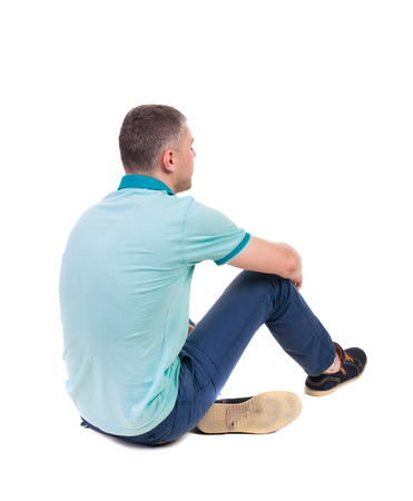 people from behind: Back view of seated handsome man in polo looking up.   Standing young guy in jeans. Rear view people collection.  backside view of person.  Isolated over white background. Stock Photo