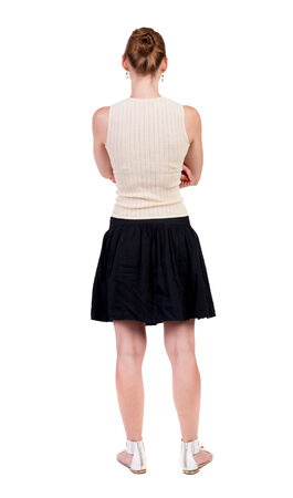back view of standing young blonde woman. Rear view people collection.  backside view of person.  Isolated over white background. photo