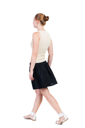 back view of walking  woman in dress. beautiful blonde girl in motion.  backside view of person.  Rear view people collection. Isolated over white background. photo