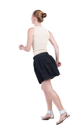 back view of running  woman in dress. beautiful blonde girl in motion. backside view of person.  Rear view people collection. Isolated over white background. photo