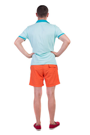 Back view of young manin shorts looking.  Rear view people collection.  backside view of person.  Isolated over white background. photo