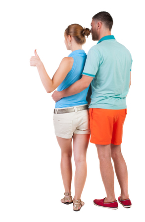 young couple pointing at wal Back view  (woman and man). Rear view people collection.  backside view of person.  Isolated over white background. photo