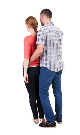 Back view of young embracing couple (man and woman) hug and look into the distance. beautiful friendly girl and guy together. Rear view people collection.  backside view of person.  Isolated over white background. photo