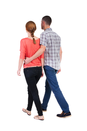 Back view going couple. walking friendly girl and guy holding hands. Rear view people collection. backside view of person. Isolated over white background.  photo