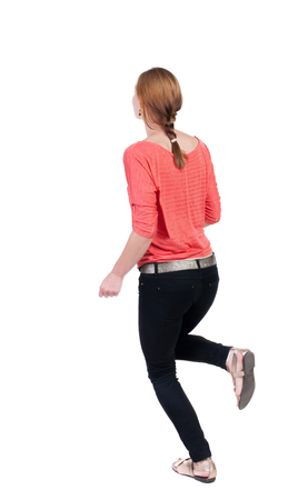 back view of running  woman in jeans. beautiful blonde girl in motion. backside view of person.  Rear view people collection. Isolated over white background. photo