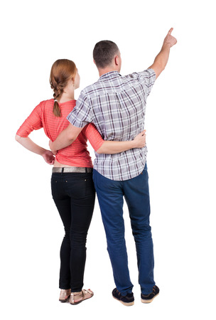 girls back to back: young couple pointing. Back view.  Rear view people collection.  backside view of person.  Isolated over white background.