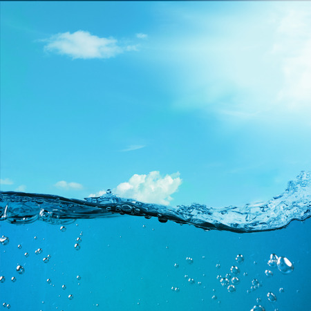 Underwater background. Wave against the sky. Blue ocean landscape photo