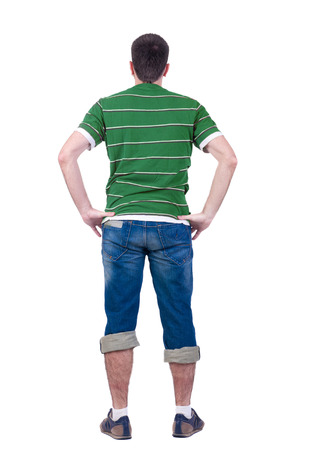 young man looks at  white background. rear view. Isolated over white . photo