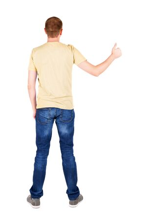Back view of  man in t-shirt. shows thumbs up.   Rear view people collection.  backside view of person.  Isolated over white background. photo