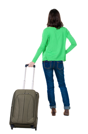 back view of walking  woman  in cardigan with suitcase. beautiful  girl in motion.  backside view of person.  Rear view people collection. Isolated over white background. photo