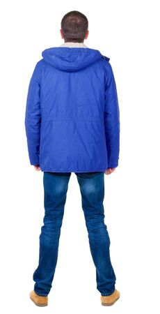 Back view of handsome man in winter jacket  looking up.   Standing young guy in parka. Rear view people collection.  backside view of person.  Isolated over white background. photo