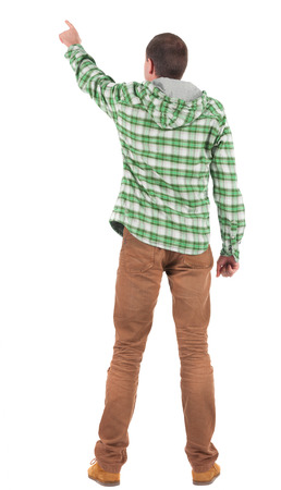 Back view of  pointing young men in  plaid shirt with hood. Young guy  gesture. Rear view people collection.  backside view of person.  Isolated over white background. photo