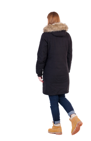 treading: Back view of going  woman in parka. walking young girl. Rear view people collection.  backside view of person.  Isolated over white background.
