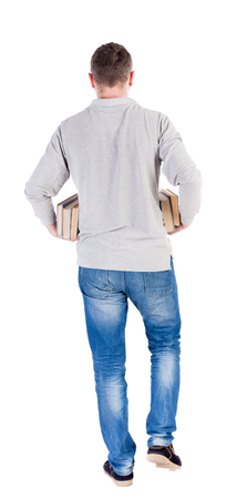 treading: Back view of going  handsome man carries a stack of books. walking young guy . Rear view people collection.  backside view of person.  Isolated over white background. Stock Photo