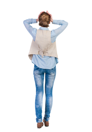 woman standing back: Back view of shocked woman in blue jeans. girl hid his eyes behind his hands.  Rear view people collection.  backside view of person.  Isolated over white background.