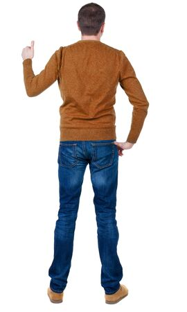 Back view of  man in blue pullove shows thumbs up. Rear view people collection.  backside view of person.  Isolated over white background. photo