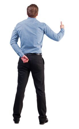 Back view of  business man shows thumbs up.   Rear view people collection. cheerful office worker shows positive emotions.  backside view of person.  Isolated over white background. with one hand behind his back, an office worker second shows gesture succ photo