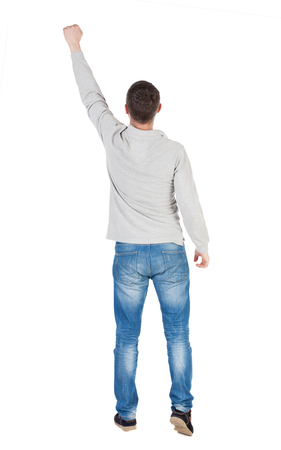 Back view of  man in checkered shirt Raised his fist up in victory sign.   Rear view people collection.  backside view of person.  Isolated over white background. photo