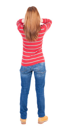 Back view of shocked woman in blue jeans. girl hid his eyes behind his hands.  Rear view people collection.  backside view of person.  Isolated over white background. photo