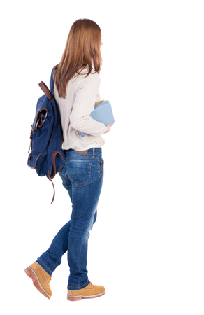 back posing: Girl with a backpack on his back is a stack of books. back view. Rear view people collection.  backside view of person.  Isolated over white background.