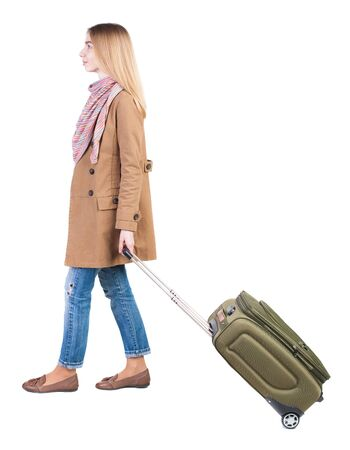 back view of walking  woman  with suitcase. beautiful girl in motion.  backside view of person.  Rear view people collection. Isolated over white background. traveling teen girl photo