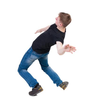 hombre cayendo: Equilibrio joven. o esquivar al hombre que cae. Vista posterior recogida de las personas. backside vista de la persona. Aislado sobre fondo blanco.