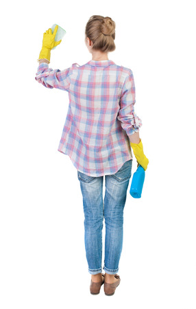 Back view of a housewife in gloves with sponge and detergent. girl  watching. Rear view people collection.  backside view of person.  Isolated over white background. photo